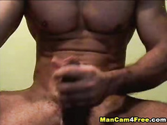 Twink with sexy tight muscles is jerking off huge dick