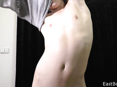 Teen boy erotically strips and plays with the cock