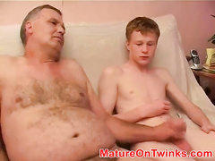 Daddy and twinks are having pretty hot masturbation 3some